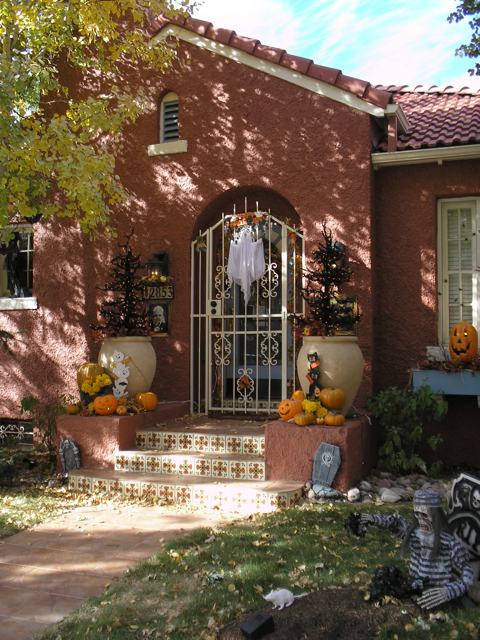porch with pumpkins and fake grave