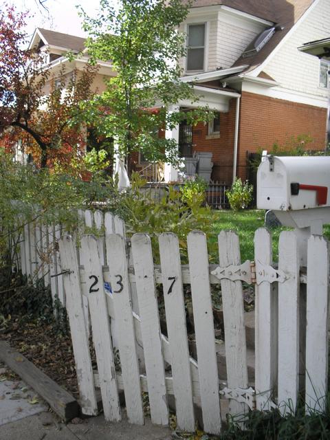 shabby white picket fence