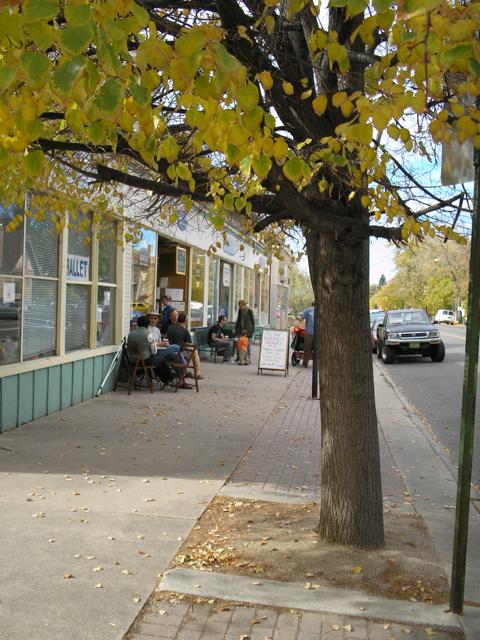 people drinking coffee outside bakery