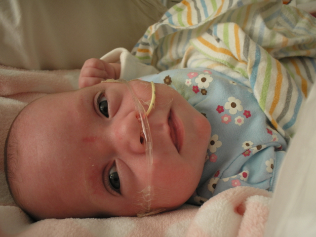 baby with cannula