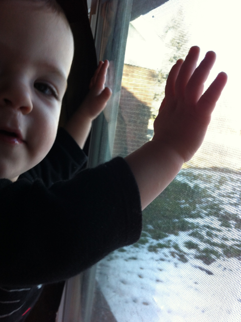 baby next to window