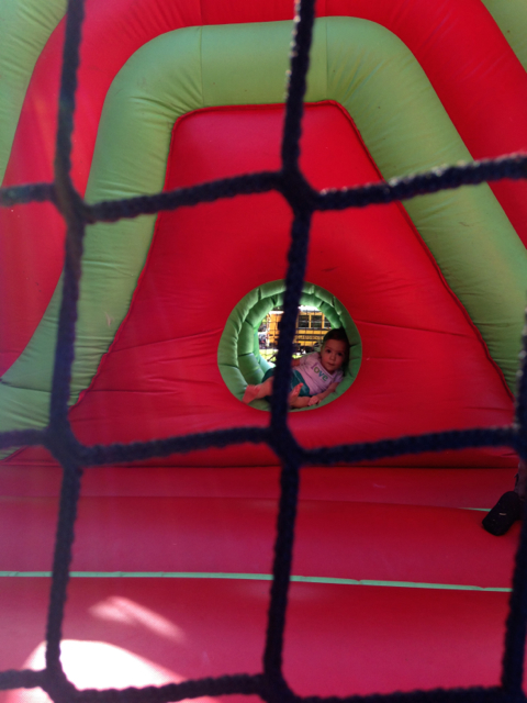 toddler in bounce house