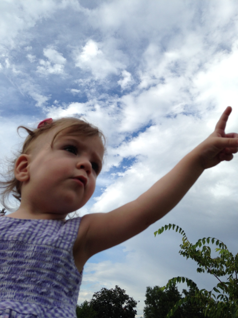 girl pointing at sky